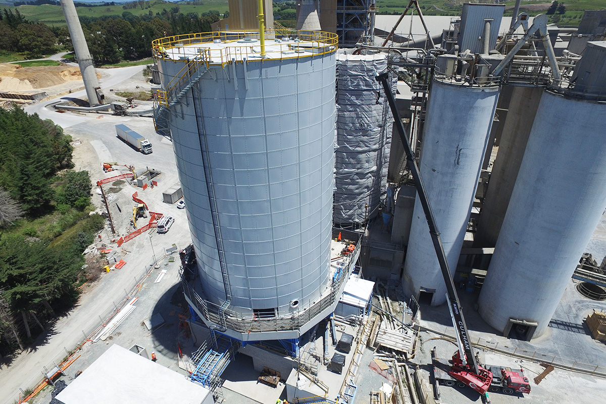 Giant bolted RTP cement storage on elevated steel and concrete platform