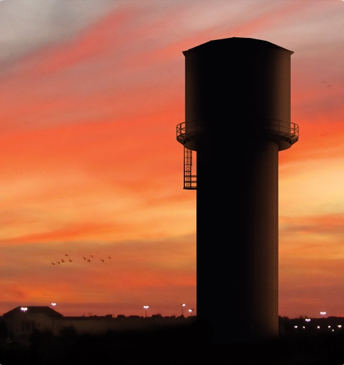 Elevated storage tank at sunset
